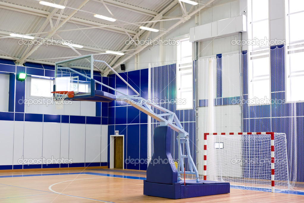 Part of sports gym with modern basketball upright and soccer goal — Stock Photo #1417190