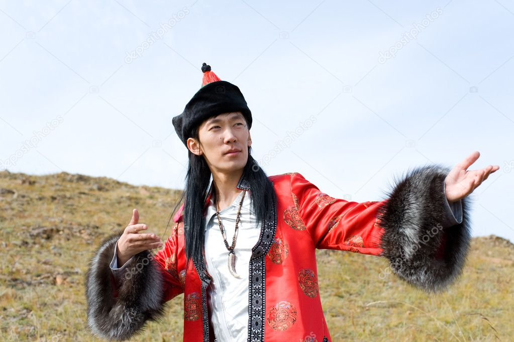 Young asian man in national Mongolian suit — Stock Photo #1418821