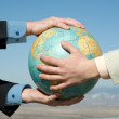 Royalty-Free Stock Photo: Male arms on earth globe