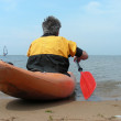 Man in kayak with red oar — Stock Photo