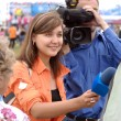 Smiling female TV reporter — Stockfoto