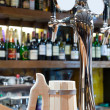 Beer faucet with a mug in a bar — Stock Photo