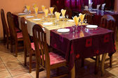 Yellow claret coloured restaurant table — Stock Photo