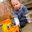 Little boy with toy truck — Stock Photo