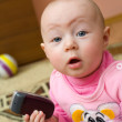 Surprised baby with cell phone — Stock Photo
