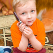 Little kid speaks over cell phone — Stock Photo #2378849
