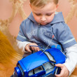 Stock Photo: Little boy with toy car