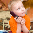 Stock Photo: Little kid speaks over cell phone