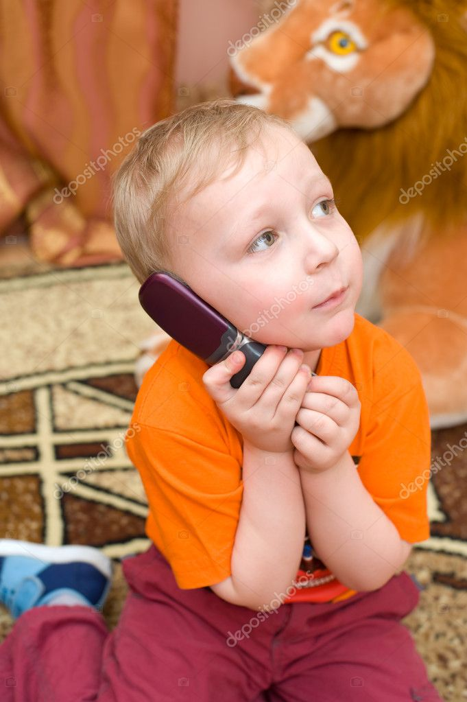Little blonde european boy speaks over cell phone  Stock Photo #2442702