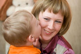 Little son kisses his Mom — Stock Photo