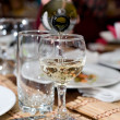 Stemware being filled with wine - Stock Photo