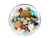 Fifty euro cents in saucer full of pills — Stock Photo