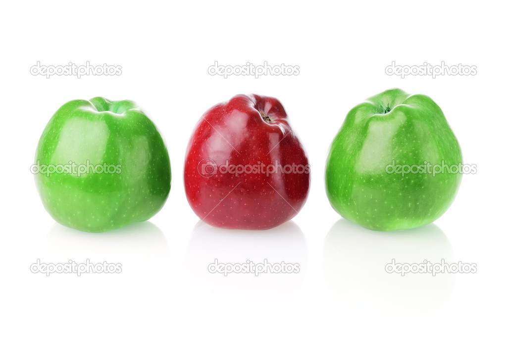 Different bright red apple between two green apples on white background — Stock Photo #1438332