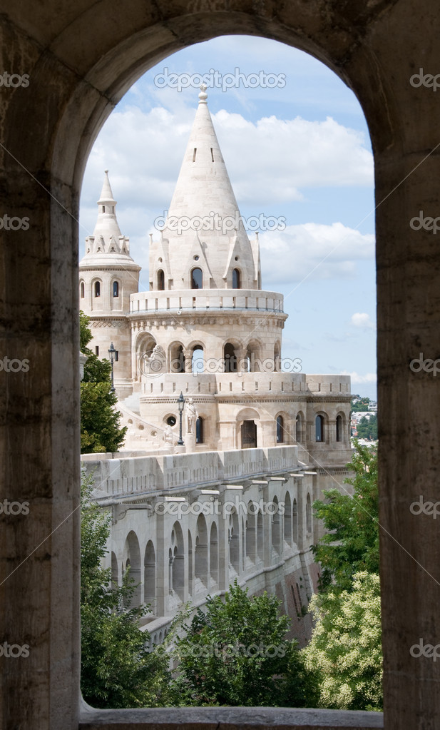 Fairytale looking Budda castle towers through  round-headed window of a tower  Foto de Stock   #1442388