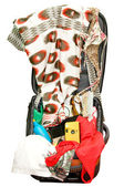 Open suitcase with things for travel — Stock Photo