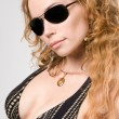 Blonde woman in sun-glasses — Stok fotoğraf