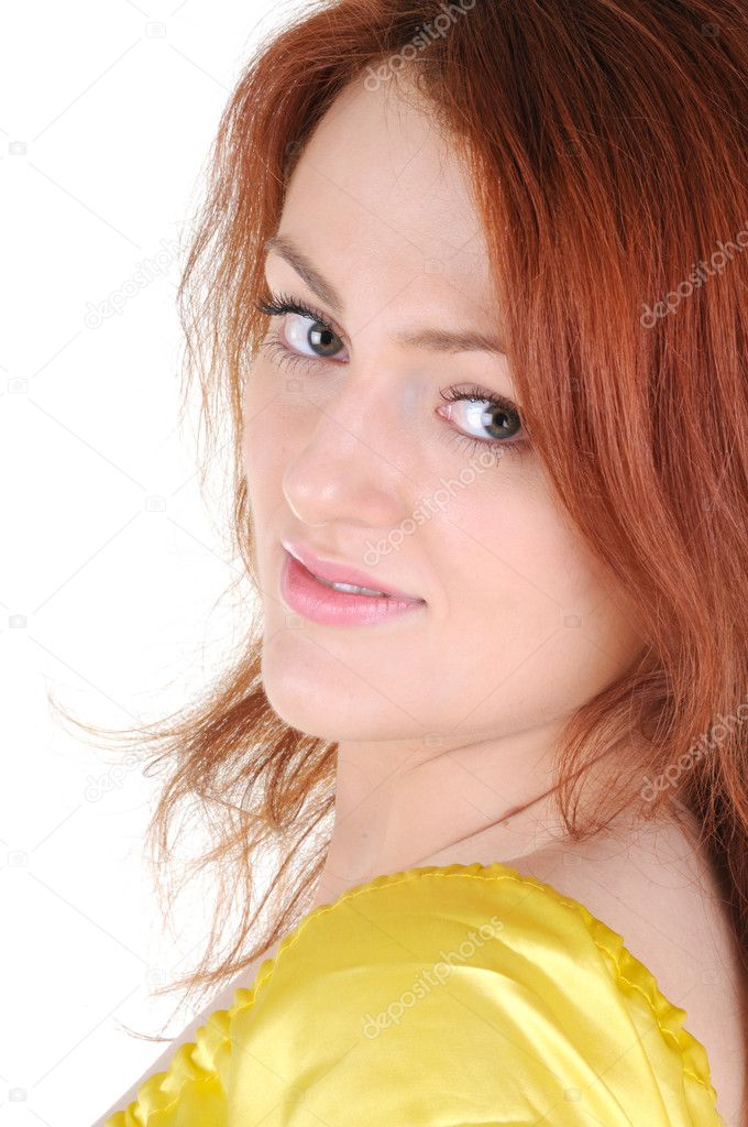 Beautiful smiling woman with red hear in a yellow dress on white background — Stock Photo #1782483