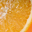 Juicy orange slice very close-up — Stock Photo