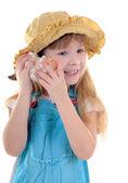 Nice smiling girl with sea shell — Stock Photo