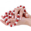 Beautiful feminine hands with necklace — Stock Photo