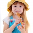 Small beauty girl with big wooden spoon — Stock Photo #2570208