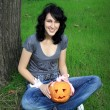 Happy teen with pumpkin — Stock Photo #1400609