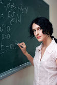 Girl at the blackboard — Stock Photo