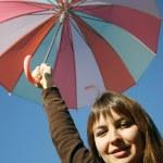 Happy girl with umbrella — Stock Photo