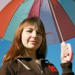 Stock Photo: Under colored umbrella