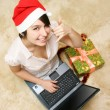 Stock Photo: Happy girl in red hat with laptop