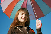 Under colored umbrella — Stock Photo