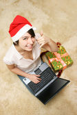 Happy girl in red hat with laptop — Stock Photo