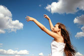 Girl dancing with clouds — Stock Photo