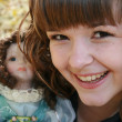 Beautiful girl with doll — Stock Photo #1461655