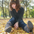 Stock Photo: Beautiful girl in autumn leaves