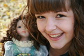 Beautiful girl with doll — Stock Photo