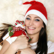 Happy girl with snowman — Stock Photo