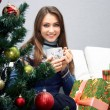 Girl sitting near the Christmas tree — Foto Stock