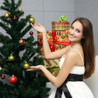Stock Photo: Pretty smiling girl with gift