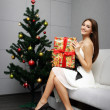 Pretty girl with gift — Stock Photo