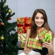 Pretty girl with gift - Stock Photo
