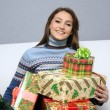 Pretty girl with gift — Stock Photo #1508944