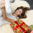 Stock Photo: Pretty girl with gift