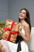 Pretty smiling girl with gift — Stock Photo