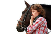 Young girl near horse looking ahead — Stock Photo