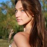 Pretty smiling dark-haired girl — Stock Photo