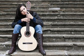 Young female guitarist — Stock Photo