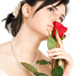 Bride sniffing a red rose — Stock Photo #1464326