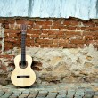 Royalty-Free Stock Photo: Guitar on old wall