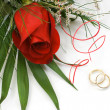 Wedding rings and rose — Stock Photo #1464746